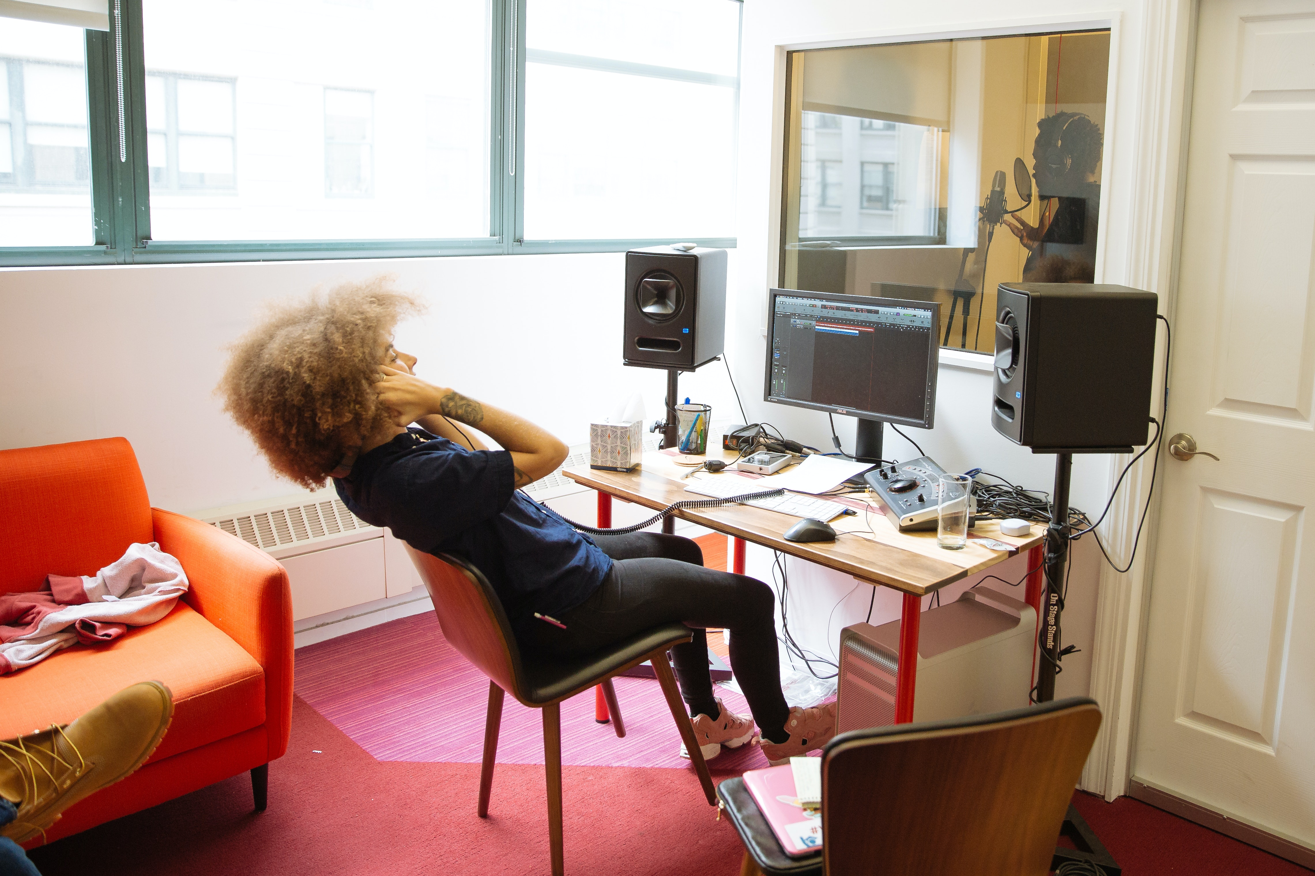 An artist records a track in Flocabulary's in-office recording studio